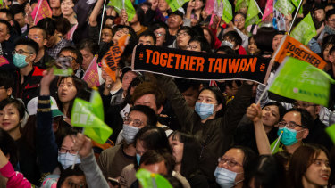 Attendees wave flags during a Democratic Progressive Party campaign rally with Taiwanese President Tsai Ing-wen in Taipei.