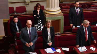 Last man sitting: Liberal MP Bernie Finn (left) refuses to stand for State Parliament's Acknowledgment to Country