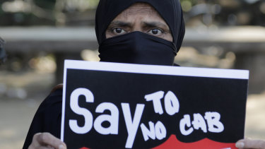 An Indian woman holds a placard during a protest against Citizenship Amendment Bill (CAB) in Ahmadabad, India.