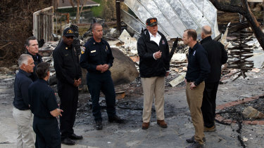 Donald Trump visits a neighbourhood impacted by the Wolsey Fire in Malibu, California, last week.