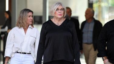Glenda Wagner (centre), sister in law of murder victim Gerhard Wagner, leaves the Supreme Court in Brisbane on Thursday.