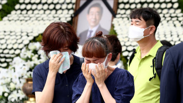 People mourn mayor Park Won-soon outside City Hall in Seoul, South Korea.