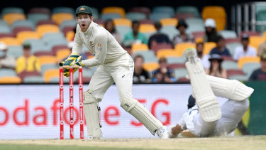 Tim Paine reacts as Cheteshwar Pujara of India makes his ground during day five of the fourth Test in the series between Australia and India at the Gabba in January.