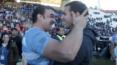 All smiles: Argentina's Agustin Creevy (left) embraces assistant coach Gonzalo Quesada after beating South Africa in 2018.