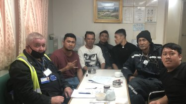 Crew members from the MV Sincere, with ITWF official Matt Purcell (left), who are desperate to get off the vessel.