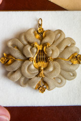 The brooch made from the hair of Caroline Newcomb and Anne Drysdale, c1853.