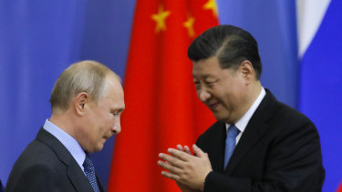 Chinese President Xi Jinping and Vladimir Putin one stage as Xi Jinping is presented with a degree from St Petersburg State University during a birthday visit to the city.