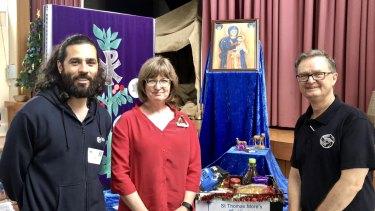 Wesley Raymond, Sonja Mingay and Kym Duggan preparing Christmas hampers for families in need.