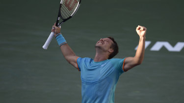Victorious: Philipp Kohlschreiber celebrates his win over Novak Djokovic.
