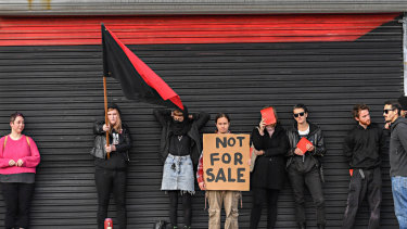 Melbourne Anarchist Club members protest outside the clubhouse during an open for inspection on Saturday afternoon.
