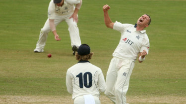 Victoria's Peter Siddle celebrates the dismissal of Moises Henriques on day two of the Shield final against NSW.