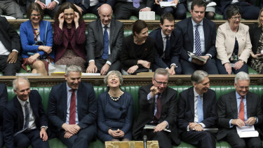 Theresa May has a quiet chuckle at it all.