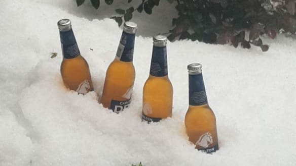 Who needs an esky? South-east Queensland residents take advantage of hail blanket