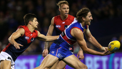 Dogs shake off the Dees to stay in hunt for finals