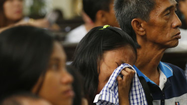 A relative cries as she pays homage to alleged victims of President Rodrigo Duterte's so-called war on drugs at a religious service ahead of the observance of All Souls Day on October 30, 2018, in Manila.