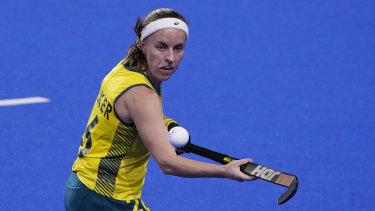 Australia's Emily Chalker knocks the ball out of the air.