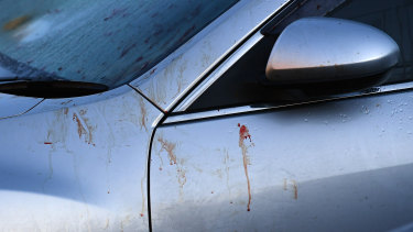 Blood is seen on a car at the scene of a brawl.