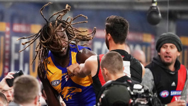 The melee started after Zach Merrett pulled one of Nic Naitanui's dreadlocks, with the big Eagle then shoving the Bomber.