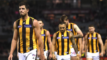 Under scrutiny: Hawthorn captain leads his team from the field after the loss to Essendon.