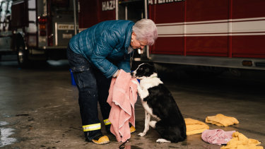 Lynne Engelbert washes Piper at a Chico fire station.