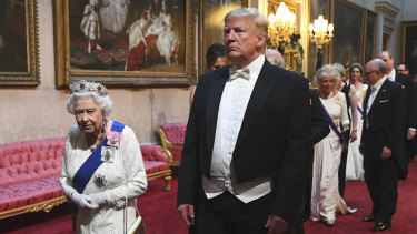 The Queen and US President Donald Trump arrive at a state banquet at Buckingham Palace in London during his state visit.