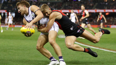 Bombers skipper Dyson Heppell lays a desperate tackle on Fremantle's Mitch Crowden.