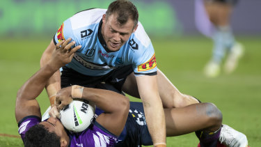 Josh Morris tackles Marion Seve of the Storm at Jubilee Stadium.