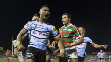 Ronaldo Mulitalo celebrates his spectacular try for the Sharks.