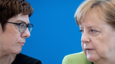 You complete me?: Angela Merkel (right) speaks to the woman known as AKK - and 'mini-Merkel' - in Berlin in May.