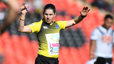 In charge: Kasey Badger referees at Panthers Stadium on Sunday.
