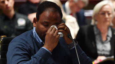 Vijay Vital wipes away tears after delivering his opening statement to the NSW upper house's inquiry into the state's building standards.