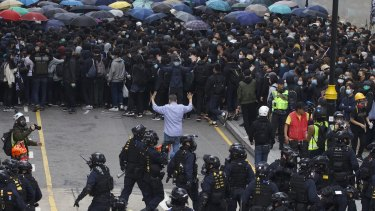 Protesters confront police in Hong Kong in January.