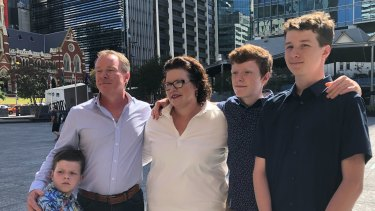 Kate Richards, accompanied by her family,  makes a statement outside Brisbane City Hall.