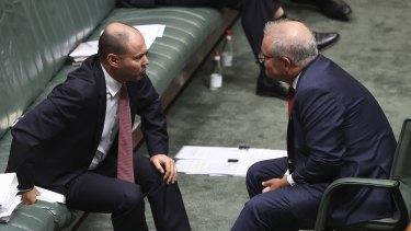 Treasurer Josh Frydenberg and Prime Minister Scott Morrison during Question Time at Parliament House.