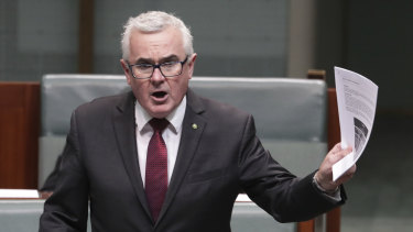 Independent MP Andrew Wilkie attempts to table the ClubsNSW internal document at Parliament House on Thursday.