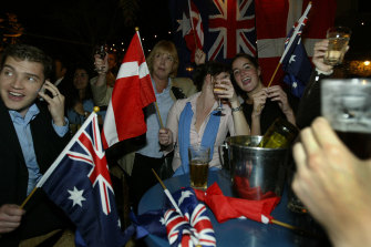 Danish and Australian flags are waved as crowds gathered in the beer garden of the Slip Inn on Sussex St,  Sydney, celebrating the Royal wedding of Mary Donaldson and Danish Prince Frederick. The Royal couple met  at the Slip Inn during the 2000 Olympic Games. 14 May, 2004.
