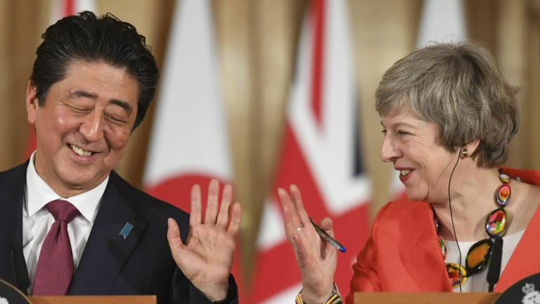 Theresa May and Shinzo Abe  hold a press conference in 10 Downing Street.