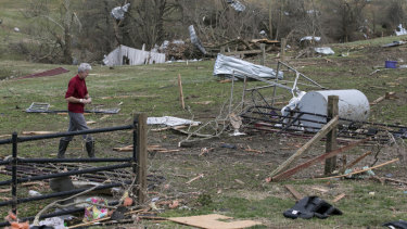 Debris litters a field after a tornado touched down in McCracken County, Kentucky.