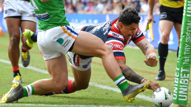Latrell Mitchell scores his first of two first-half tries against the Raiders.