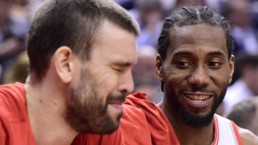 Raptors Marc Gasol and Kawhi Leonard enjoy the second half of game five.