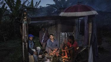 Ninot Oclin, centre, guards his small vanilla farm from thieves in Mandena, Madagascar.