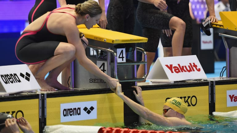 Too strong: Cate Campbell reaches out after touching the wall in the women's 4x100m relay.