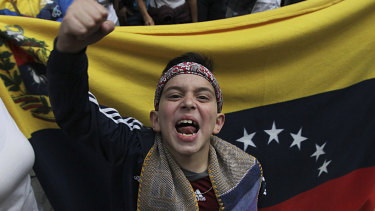 Venezuelans protest outside the Venezuelan embassy in Mexico City.