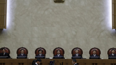 South Korean Chief Justice of the Supreme Court Kim Myeongsu, centre, with other justices in Seoul.