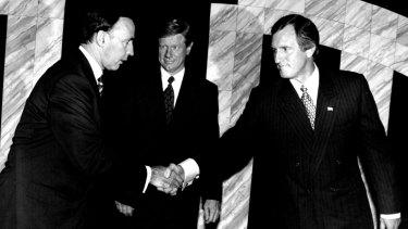 Paul Keating and John Hewson shake hands before their 1993 debate on national television.