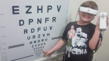 Max testing eSight glasses at the Royal Society for the Blind in Adelaide.