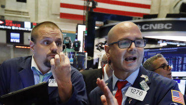 Wall Street remains near record highs despite the US economy being battered by the pandemic.