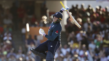 Momentous: Jason Roy celebrates his ton in the record-breaking Barbados showdown.