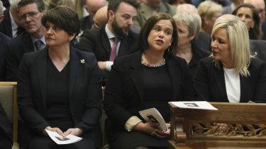 Democratic Unionist leader Arlene Foster (left) and Sinn Fein leader Mary Lou McDonald (centre) sit together at Lyra McKee's funeral, but cannot form a power-sharing government.