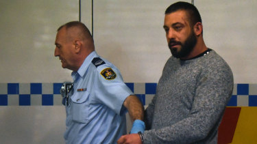 Ricardo Barbaro is escorted to a prison van at Burwood Court in Sydney on Thursday.